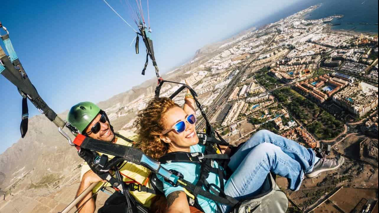 Cheerful happy woman to paraglyde experience