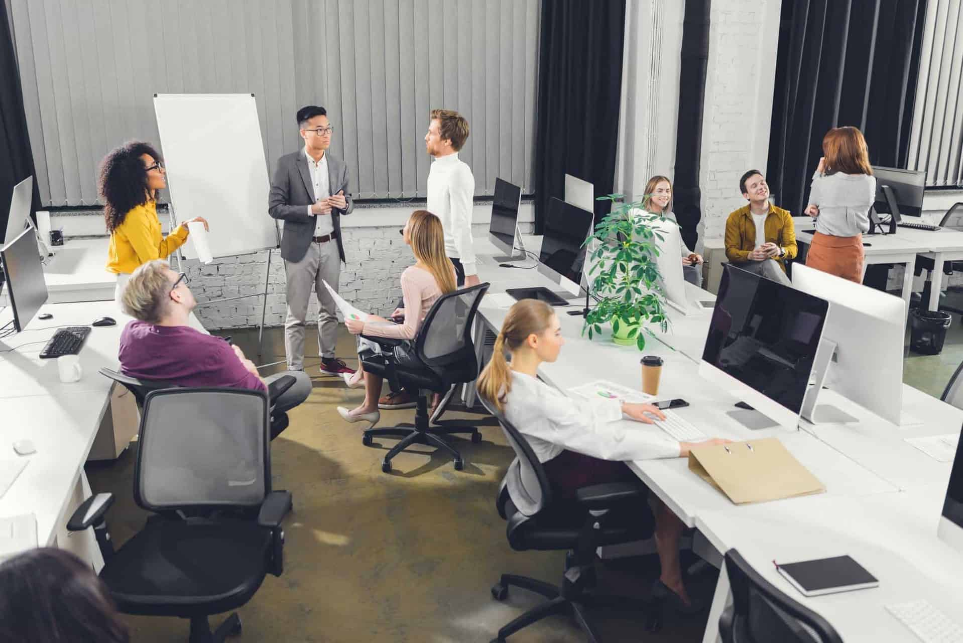 professional young multiracial businesspeople working together in open space office